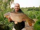 Jon Lungley with a 29lb 4oz Common - June 2002