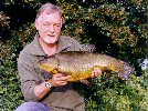Alan Pearce with a stunning 10lb 1oz tench - June 2004