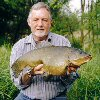 Alan Pearce with a awesome 10lb 5oz tench - May 2004