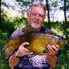 Alan Pearce with a beautiful 9lb 2oz tench - May 2004