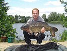 Charlie with a 23lb 1oz Common - Aug 2004