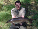 Jon Coote with a 11lb 73oz Barbel - July 2006
