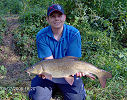 Jon Coote with a spectacular 11lb 7oz Barbel - July 2006