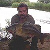 At Last!!! Dave White with a 17lb 20z two tone carp - July 2005