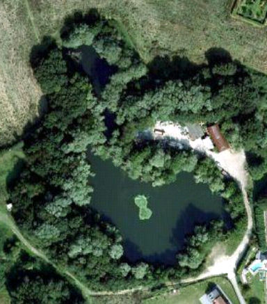 An overhead picture of Rectory Pool in the summer, clearly showing the lilly pads in the middle.